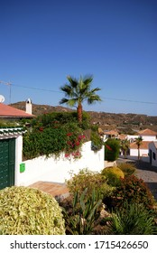 View along a village street, Macharaviaya, Costa del Sol, Malaga Province, Andalucia, Spain.