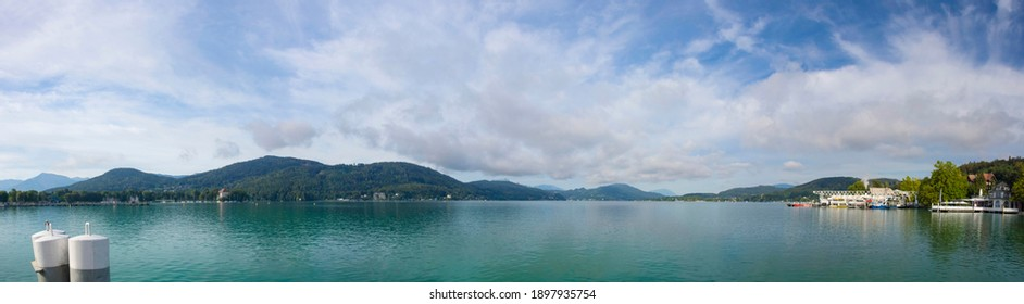 View of the alpine Lake Worthersee, famous tourist attraction for swimming, boating, sunbathing and walking, in Klagenfurt, Carinthia region, Austria. Selective focus