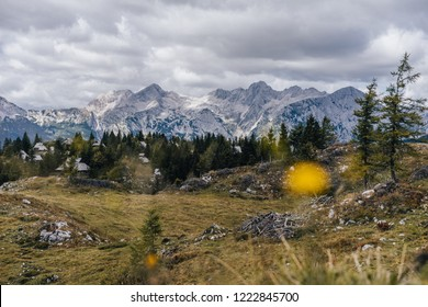 View of an alpine mountain landscape of Kamnik Savinja alps and the famous huts of Velika Planina. An autumn view of the Alps in Slovenia, pastures, high peaks and summits.