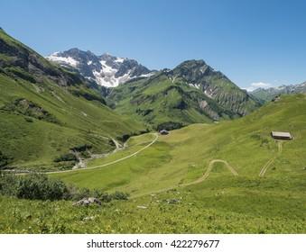 A view of Alpine mountains and the Koerbersee lake near the village Schroecken in Bregenzerwald, region Vorarlberg, Austria