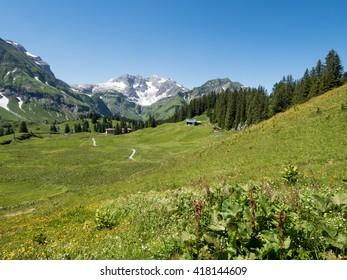 A view of Alpine mountains surrounding the village Schroecken in Bregenzerwald, region Vorarlberg, Austria