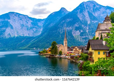 View of the Alpine town of Hallstatt on the shore of a mountain lake at sunset