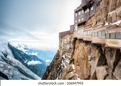 View of the Alps from Aiguille du Midi mountain in the Mont Blanc massif in the French Alps. Summit tourist station in foreground. Alps, France, Europe.