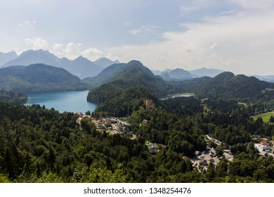 View of Alpsee and Hohenschwangau castle from Neuschwanstein castle, Bayern, Germany