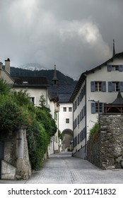 View in the Alte Simplonstrasse, a beautiful street in the old Swiss city brig, in the background te mountains - Shutterstock ID 2011741832