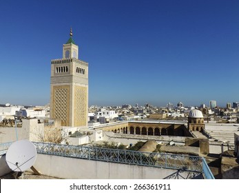 "View of the Al-Zaytouna Mosque and the skyline of Tunis. The mosque is a landmark of Tunis. In the background the modern buildings of the new City or ""ville nouvelle"""