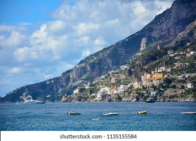 A view of Amalfi Coast, Italy, a popular tourist destination on the Mediterranean sea, with the town of Atrani and boats