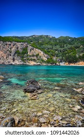View of the amazing bay with beautiful crystal clear water and cliffs in Paleokastritsa, Corfu, Greece.