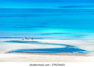 View of the amazing beach of Balos, with a family playing on the tropical sandy beach with turquoise waters, Crete, Greece