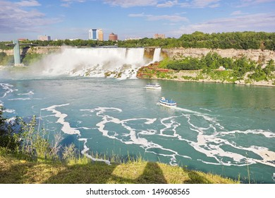 A view of the American Falls across the Niagara River as viewed from the Canadian Side in the late afternoon hours of summer.