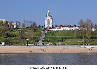 View from Amur River on Dormition Cathedral, stairs to embankment and city beach in Khabarovsk, Far East, Russia