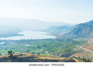 View from Anarchist Mountain Lookout of Osoyoos and Osoyoos Lake in summer with forest fire smoke in distance