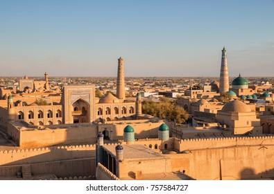 View of the ancient fortress Ichan Kala from the observation deck at sunset, Khiva, Uzbekistan
