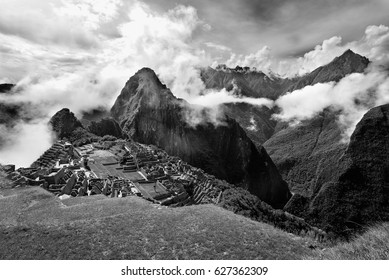 View of the ancient Inca City of Machu Picchu. The 15-th century Inca site.'Lost city of the Incas'. Ruins of the Machu Picchu sanctuary. UNESCO World Heritage site.  Black and White