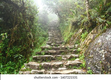 A view of the ancient Inca stairs in Inca Trail under heavy fog, Peru.
