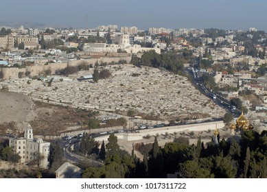 View of the ancient Jewish grave on Mount of Olives, with stone tombstone plates, Old City Jerusalem, Israel.