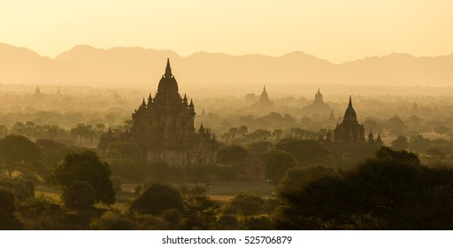 View of ancient temples in foggy morning, sunrise in Bagan, Myanmar