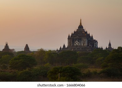 View of the ancient That Bin Nyu (Thatbinnyu) Temple in Bagan, Myanmar (Burma) at sunset. It was built in the mid-12th century. Temple is under restoration after an earthquake.