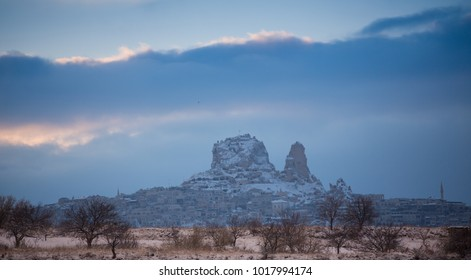 View of ancient Uchisar cave town and a castle of Uchisar dug from a mountains in Cappadocia, Central Anatolia,Turkey. Winter time with sun