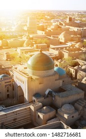 View of ancient walled city Itchan Kala from Islam Khoja Minaret during sunset in Khiva, Uzbekistan