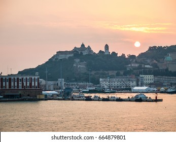 View of the Ancona harbor, with the San Ciriaco cathedral on the top of the hill in the background.