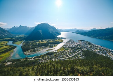 View of Andalsnes city- mountaineering capital. Hiking on the ridge of Romsdalseggen in Norway. It is one of the world's most scenic hikes