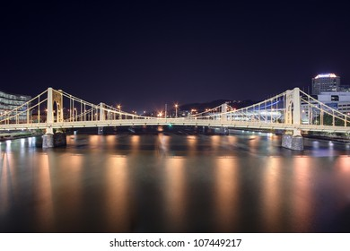 A view of the Andy Warhol Bridge overlooking the Allegheny River in Pittsburgh, Pennsylvania at night