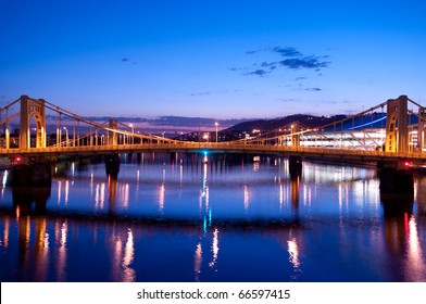 A view of the Andy Warhol Bridge overlooking the Allegheny River in Pittsburgh, Pennsylvania at sunrise.