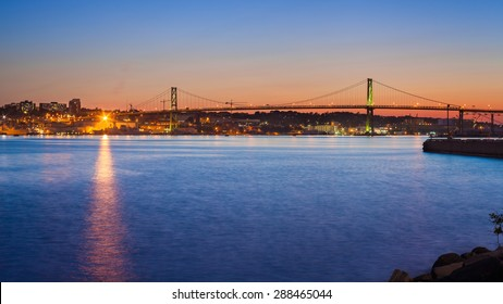 View of the Angus L. Macdonald Bridge at twilight. The bridge connects downtown Halifax with Dartmouth. Halifax, Nova Scotia, Canada.