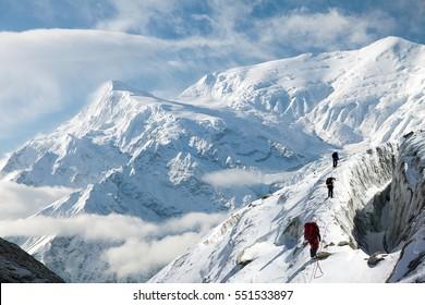 View of Annapurna 3 III and group of tourist, round Annapurna circuit trekking trail, Nepal