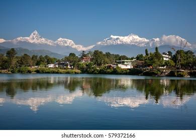 View at Annapurna mountain range and its reflection in Phewa lake in Pokhara, Nepal