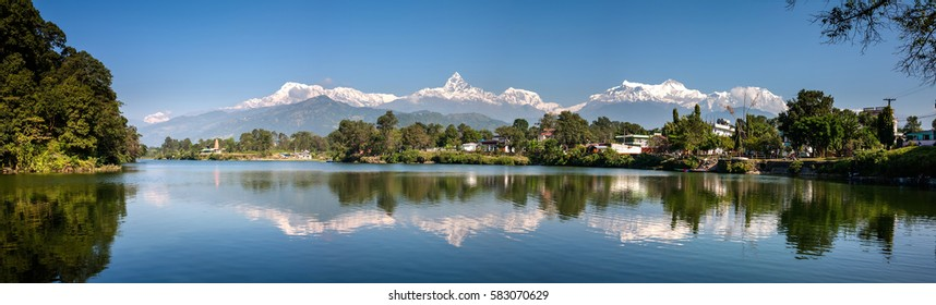 View at Annapurna mountain range and its reflection in Phewa lake in Pokhara, Nepal