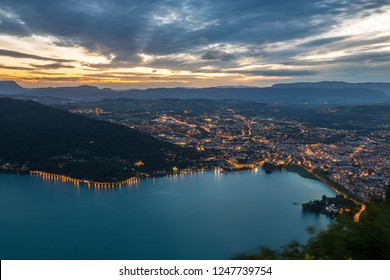 View of the Annecy lake with cityscape at night ,France.