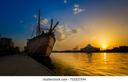 View of an antique wooden ship in the backdrop of a beautiful sunset from Sharjah