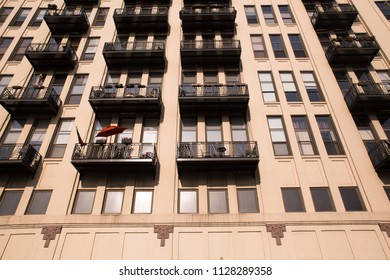View of apartment building exterior with windows and balconies