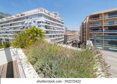 view of apartment building of one of densely populated districts of Monaco from roof