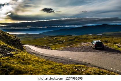 View From Applecross Pass To Scenic Landscape With Curvy Single Track Road And The Isle Of Skye In Scotland