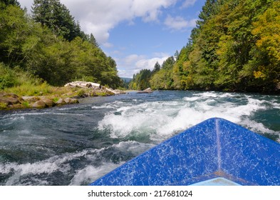 View of approaching white water on a bright summer day from a drift boat on Oregon's Mckenzie River near Eugene Oregon.