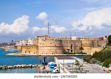 View of the Aragonese castle of Taranto, the old city and the industrial port, from the waterfront. Puglia, Italy
