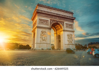 View of Arc de Triomphe, Place Charles de Gaulle and the avenue Champs-Elysees on a sunny summer day. Famous touristic places and romantic travel destinations in Europe. Long exposure. Toned