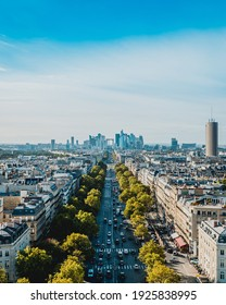 The view from Arc de triomphe de l'Étoile in a sunny day with some clouds