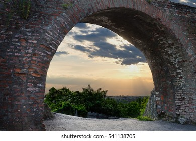 view from the arch of the old castle at sunset