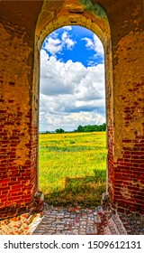 View from arch at summer meadow. Arch doorway in nature. Arch door summer meadow view. Arch doorway nature