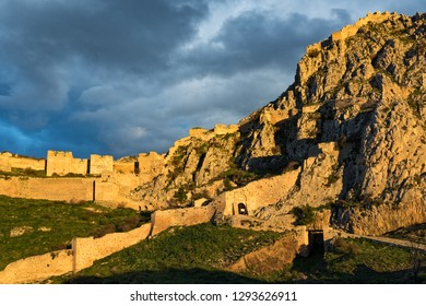 View of the archaeological site of Acrocorinth, the acropolis of ancient Corinth in Peloponnese, Greece at sunset