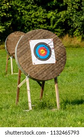 View of archery target with arrows sticking in various circles