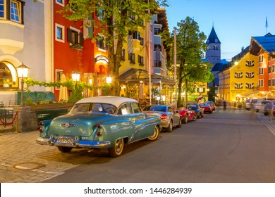 View of architecture and classic car on Vorderstadt at dusk, Kitzbuhel, Austrian Tyrol Region, Austria, Europe 1-5-2019