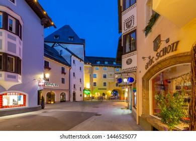 View of architecture and shops on Vorderstadt at dusk, Kitzbuhel, Austrian Tyrol Region, Austria, Europe 1-5-2019