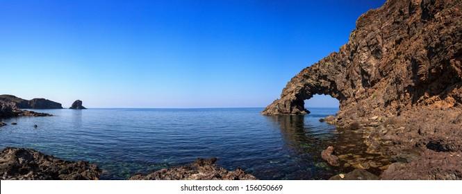 View of Arco dell'Elefante and Faraglioni in the Pantelleria island, Sicily