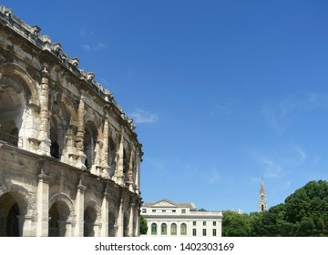 View at Arena of Nimes, Roman amphitheater, the court of Justice and the Church Sainte Perpetue in France