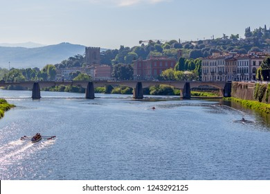 View of the Arno River in Florence with rowing boats